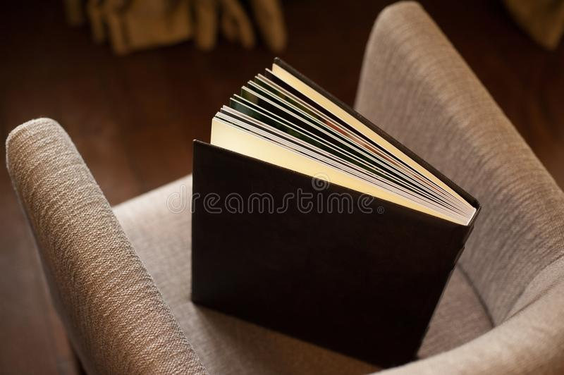 Large book on armchair royalty free stock image