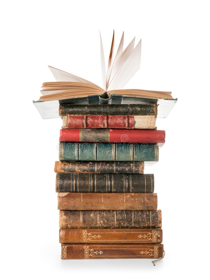 Large books pile with single open book isolated with clipping path royalty free stock photo