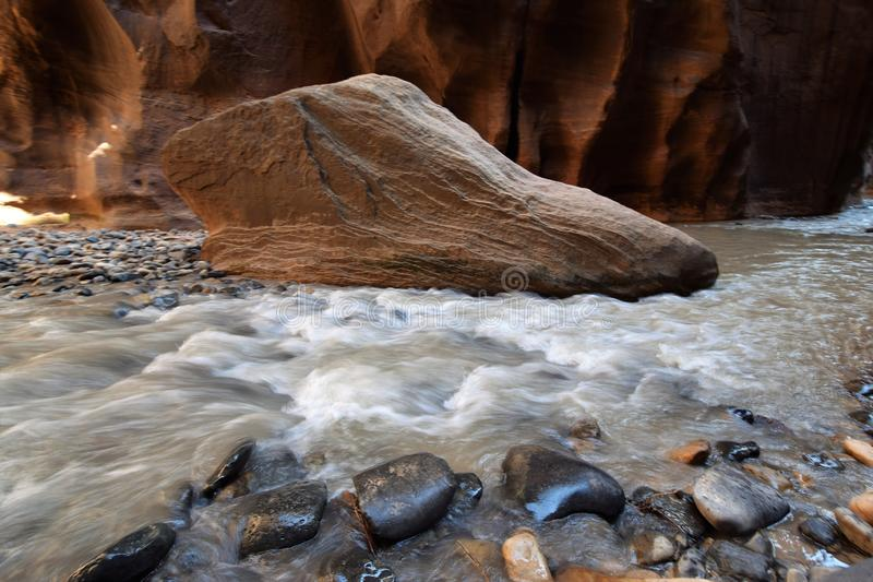 Large Boulder amid Running River royalty free stock image
