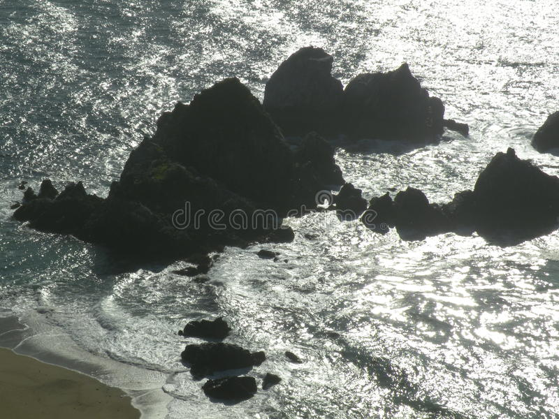 Large boulders California shore line stock images