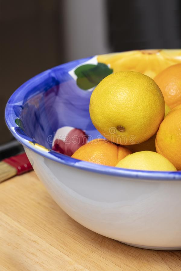 Large Bowl of Colorful Lemons and Oranges royalty free stock image