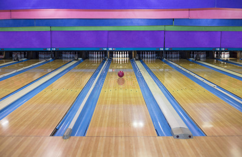 Large Bowling Alley With A Ball Rolling Down The Lane ...