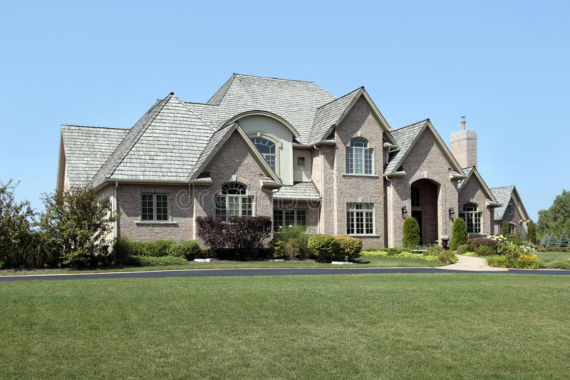 Large brick home with arched entry. Large brick home in suburbs with arched entry stock image