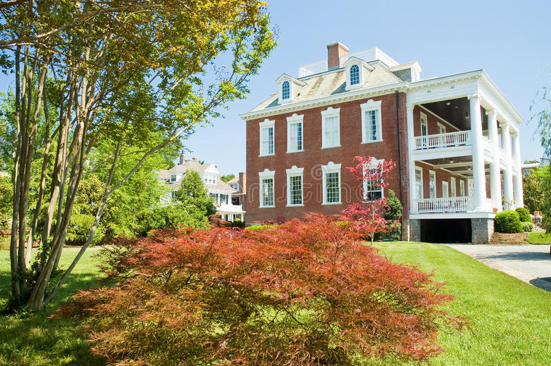 Large Brick Mansion With Porch Stock Photography
