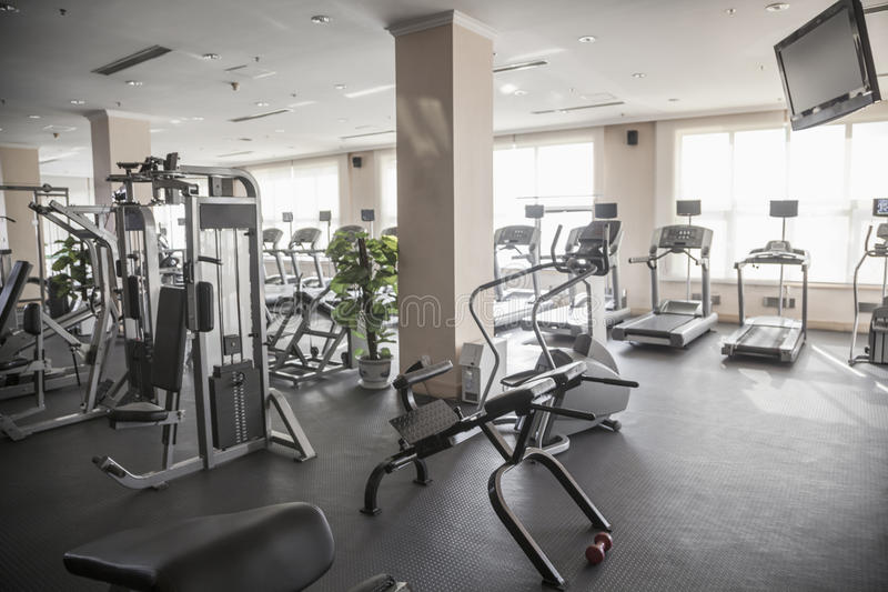 Large, bright gym with workout equipment. stock photography