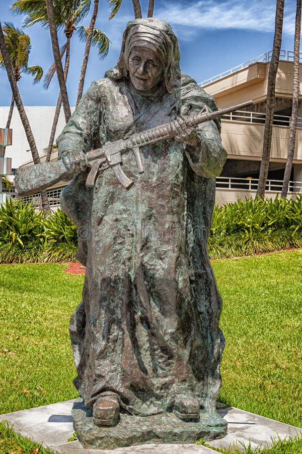 This large bronze statue of Mother Teresa is one of nine works in Bayfront Park for Art Basel. The exhibit titled WAR to WAR featu stock image