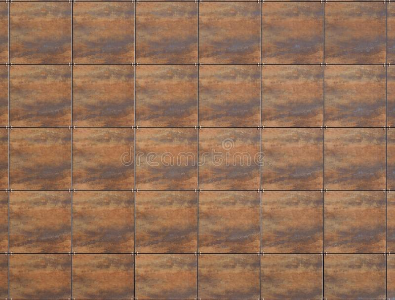 Large brown aluminium square tiles with wood effect  for modern ventilated building facade. Or walls stock photo