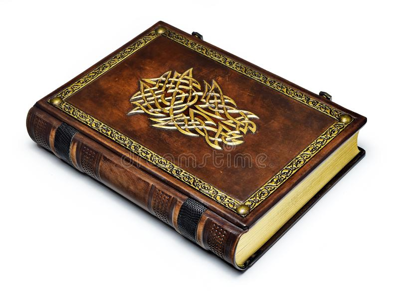 Large brown book with gilded helmet. And the frame captured while lay down to the table isolated royalty free stock images