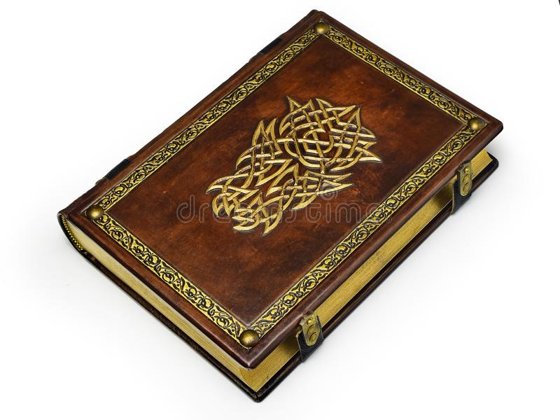 Large brown book with gilded helmet and the frame. Captured while lay down to the table isolated royalty free stock photo