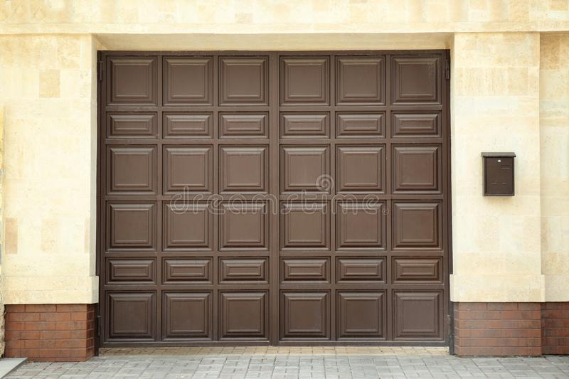 Large brown gate in modern wall royalty free stock images