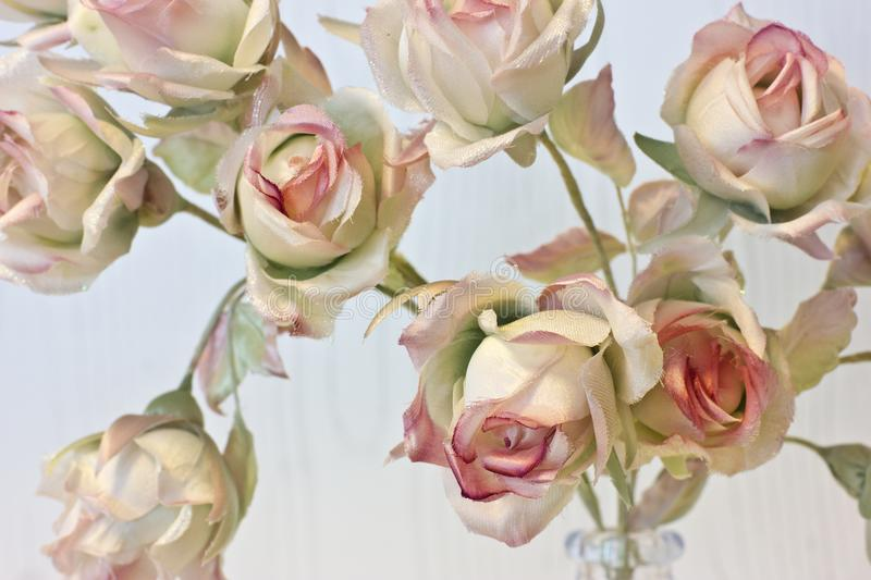 Large buds of pink and white roses. Artificial silk flowers in t. Large buds of pink and white roses. Artificial silk flowers at the interior stock photos
