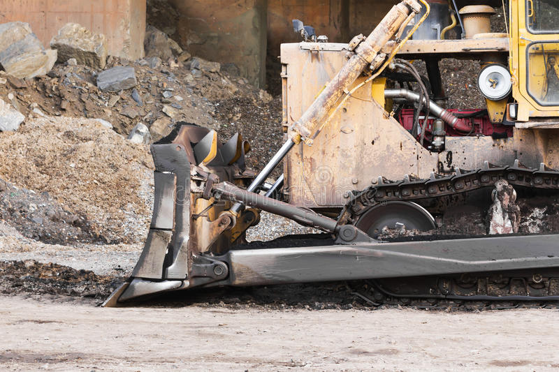 A large bulldozer in construction site. Part of bulldozer track in construction site royalty free stock images