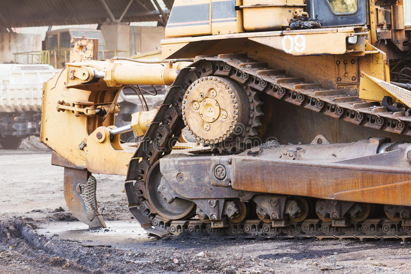 A large bulldozer in construction site. Part of bulldozer track in construction site stock images