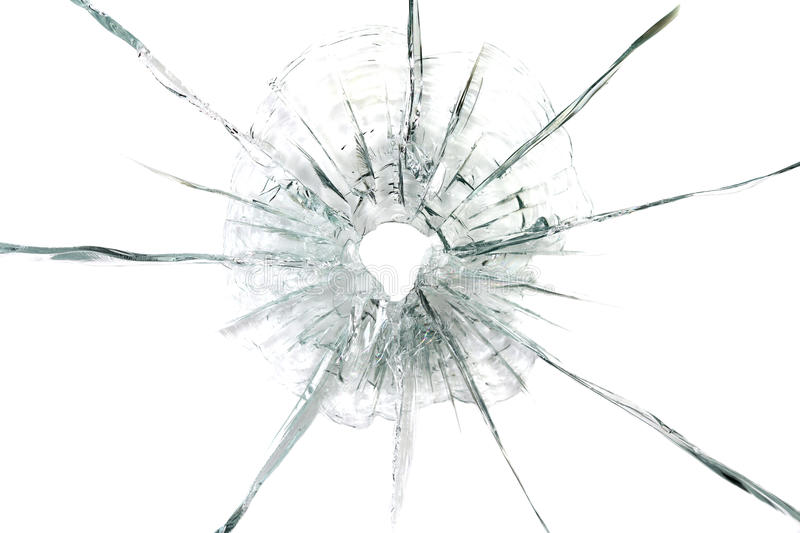 Large bullet hole in glass background royalty free stock photo