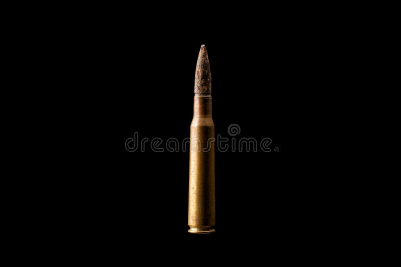 Large bullet isolated on black background. stock photo