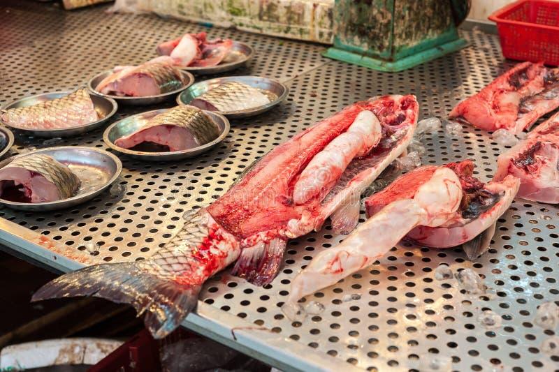Large butchered fish on sale at a Hong Kong wet market. HONG KONG - SEPT 12, 2013 - Large butchered fish on sale at a Hong Kong wet market royalty free stock image
