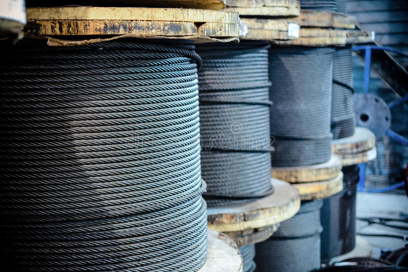 Large cable reels stocked in the factory premises. Workshop production of cable slings royalty free stock image