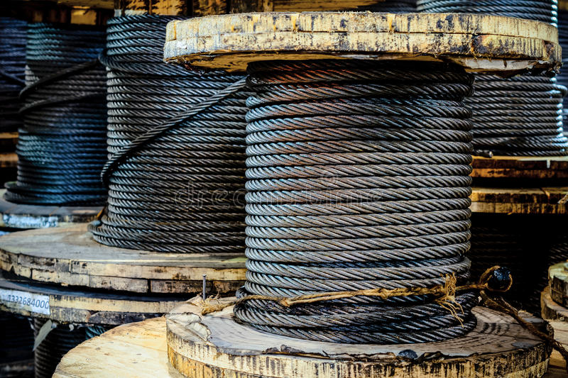Large cable reels stocked in the factory premises. stock images