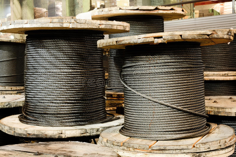 Large cable reels stocked in the factory premises. stock photo