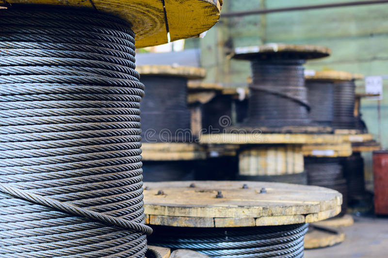 Large cable reels stocked in the factory premises. stock image