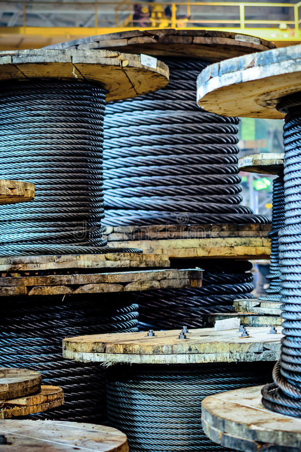 Large cable reels stocked in the factory premises. royalty free stock photos