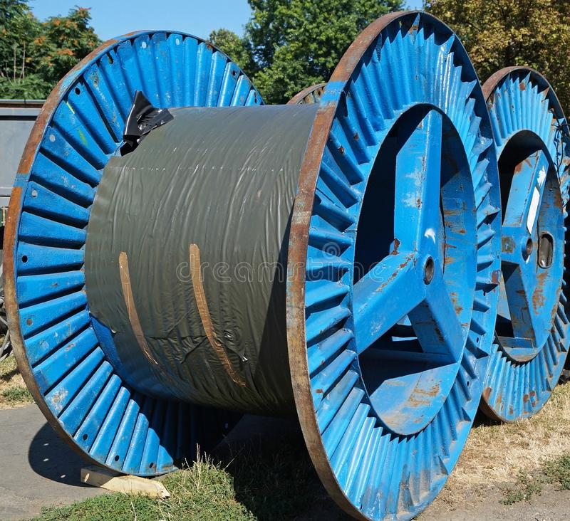 Large cable reels on the street stock image