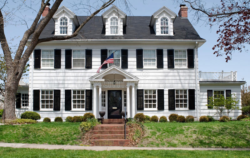Georgian Colonal House. Large two-story Midwest Georgian Colonial house with dormers & shutters stock photos