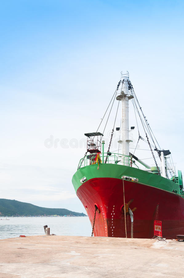 Large cargo ship with many shipping container in harbor royalty free stock image