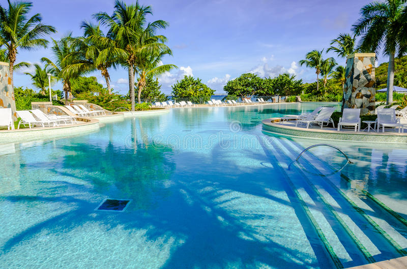 Large Caribbean Pool by the Ocean - St. Maarten stock photography