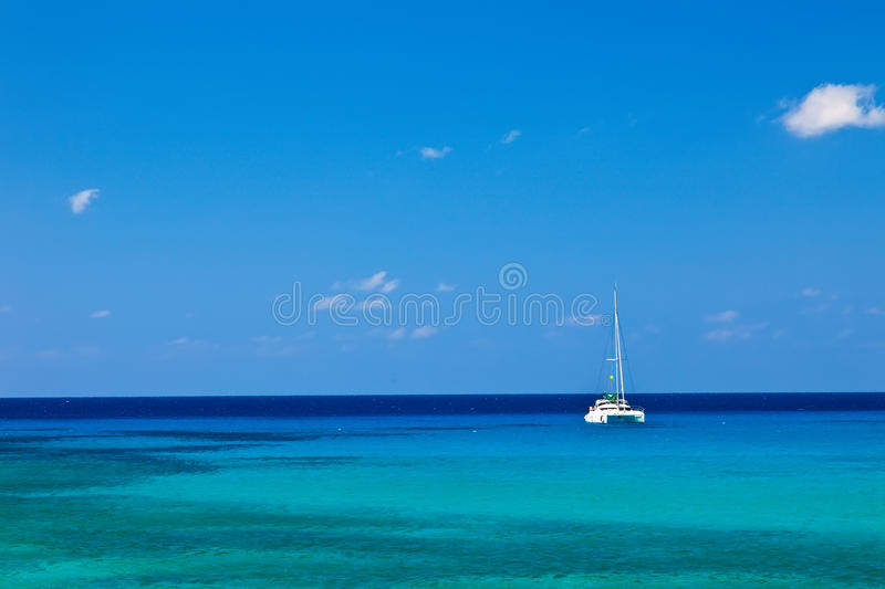 Grand Cayman. Large catamaran sailing in Grand Cayman, Cayman Islands royalty free stock photo