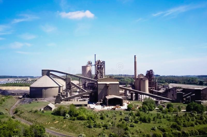 Large cement plant. The production of cement on an industrial scale in the factory.  royalty free stock photography