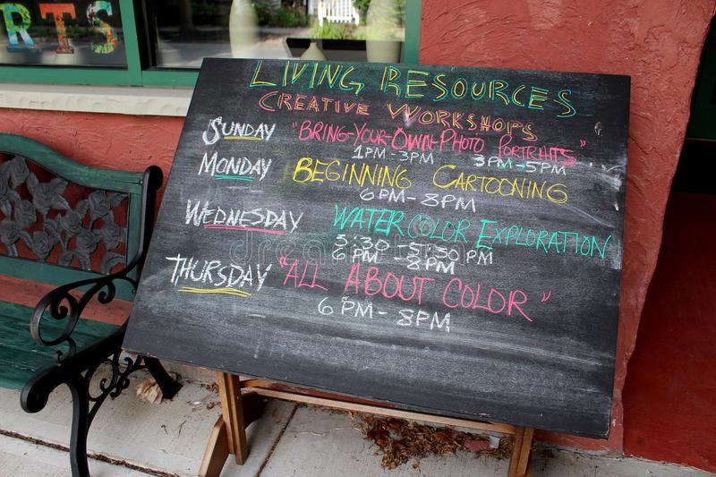 Large chalkboard with classes to register for, Living Resources, Beekman Street, Saratoga New York, 2018 royalty free stock images