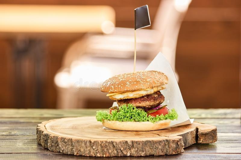 Large cheeseburger with flag. stock image