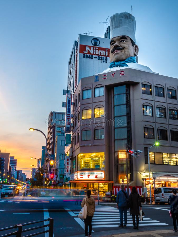 Large Chef`s head on top of Niimi building in Kappabashi royalty free stock images