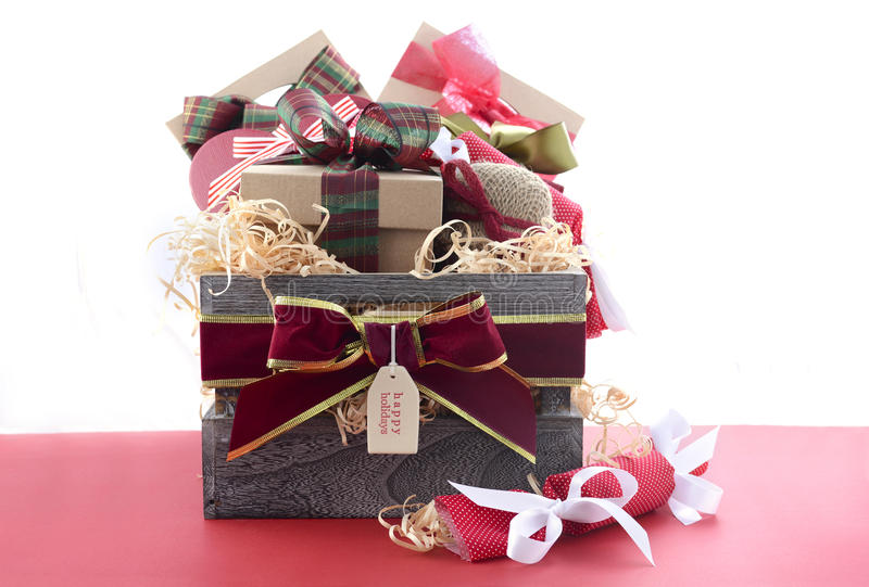 Large Christmas Gift Hamper. With traditional red and green wrapping on red wood table royalty free stock photos