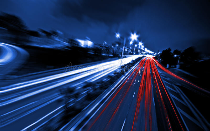 Large city road night scene, night car rainbow light trails stock photo