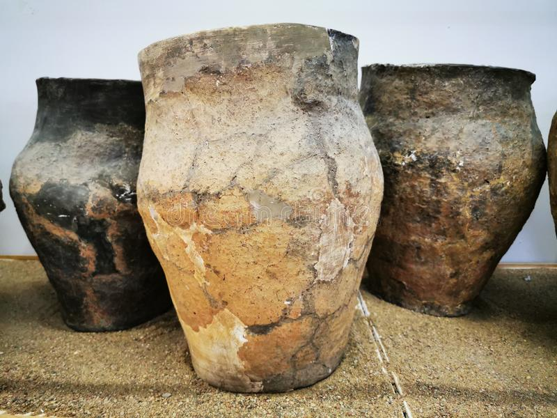 Large clay pots, vessels of the ancient Prussian era, from archaeological excavations. Kaliningrad, Russia - September 10, 2019: Local history Museum Large clay stock illustration