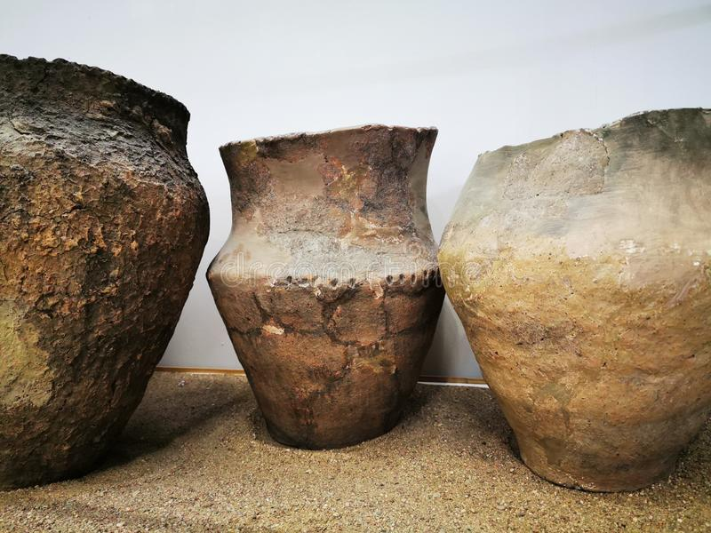 Large clay pots, vessels of the ancient Prussian era, from archaeological excavations. Kaliningrad, Russia - September 10, 2019: Local history Museum Large clay royalty free illustration