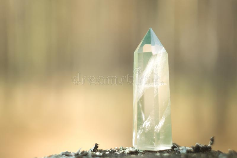 Large clear pure transparent great royal crystal of green quartz chalcedony diamond on nature blurred bokeh background close up royalty free stock photography