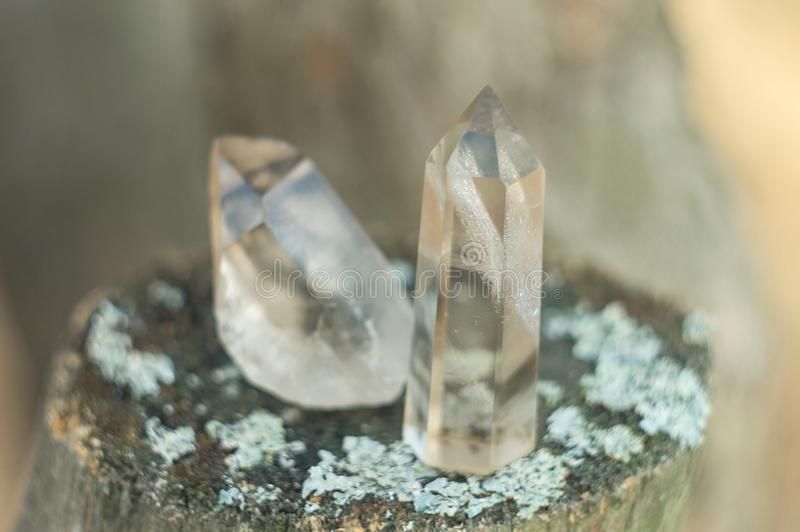 Large clear pure transparent great royal crystal of quartz chalcedony diamond brilliant on nature blurred bokeh background closeup stock photos