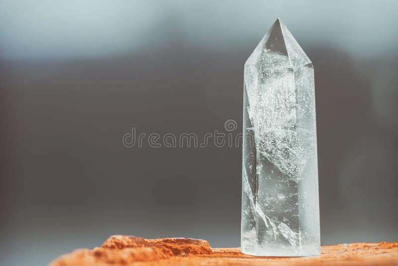 Large clear pure transparent great royal crystal of quartz chalcedony diamond brilliant on nature background close up copy space. Large clear pure transparent stock photography