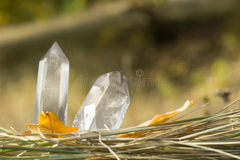 Large clear pure transparent great royal crystals of quartz chalcedony diamond brilliant on nature blurred bokeh autumn background. Large clear pure transparent royalty free stock photos