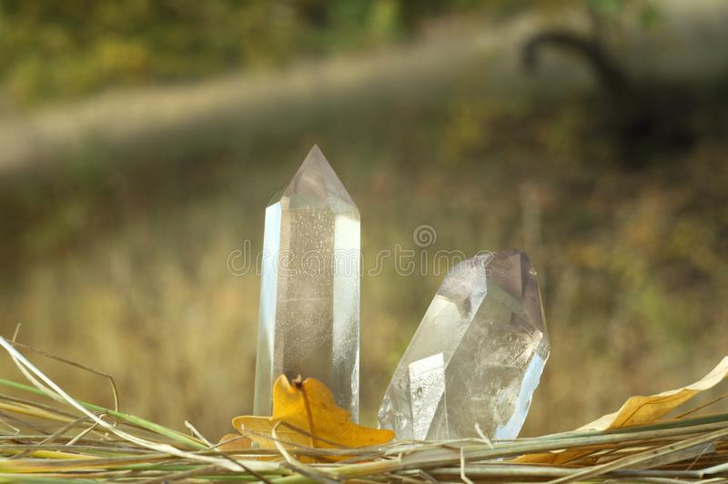 Large clear pure transparent great royal crystals of quartz chalcedony diamond brilliant on nature blurred bokeh autumn background. Large clear pure transparent stock image