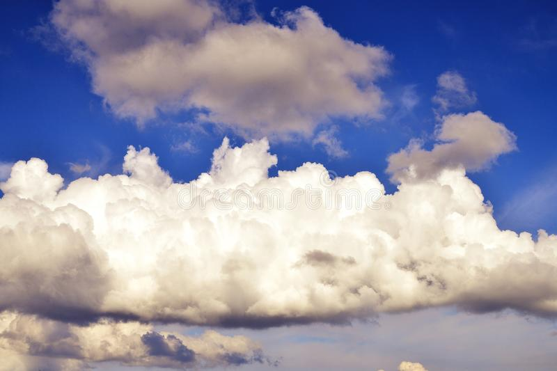 Big cloud in the blue sky. Large cloud on a blue sky close-up, toning royalty free stock photo