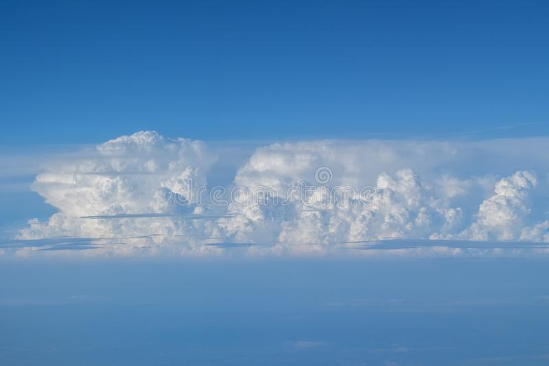 Large cloud and blue sky. Seen from aircraft flying in cruise altitude royalty free stock images