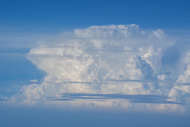 Large cloud and blue sky. Seen from aircraft flying in cruise altitude stock photo
