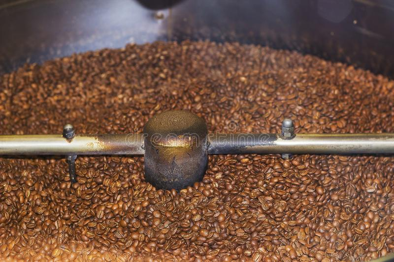 Large coffee mill grinds coffee beans royalty free stock photography