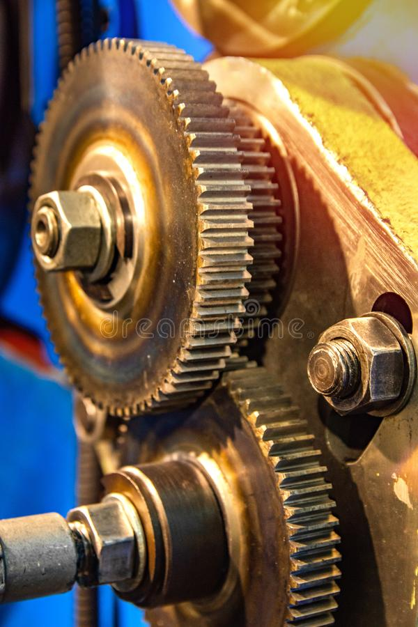 Large cog wheels in the motor Gear box of mechanism in a factory. Large cog wheels in the motor Gear box of the mechanism in a factory stock photography