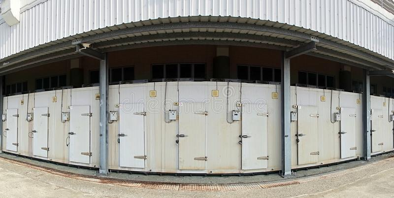 Large Cold Storage Facility. A row of walk-in refrigerators and freezer at a commercial cold storage facility stock images