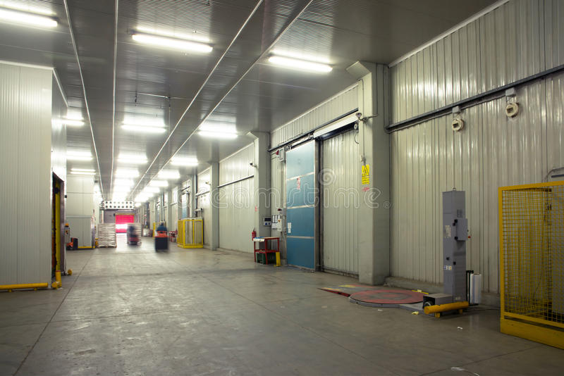 Large cold warehouse. Frozen food at shelves in cold warehouse royalty free stock images
